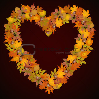 Autumn leaves heart shaped background