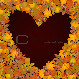 Background heart made of autumn leaves