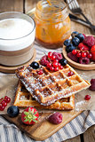 Belgian waffles with fresh berries and cappuccino
