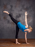 young woman doing yoga asana