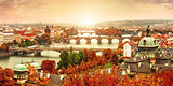 Sunset landscape view to Charles bridge on Vltava river in Prague