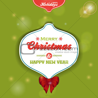 Christmas bauble label on green background