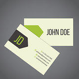 Business card design with green arrow ribbon