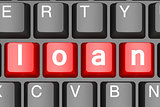 Red loan button on modern computer keyboard
