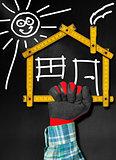 House Project - Wooden Meter on Blackboard