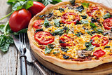 Pizza with tomatoes and cheese close up.