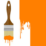 Paintbrush with dripping orange paint isolated over a painted wa