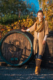 Full length portrait of woman standing in autumn vineyard