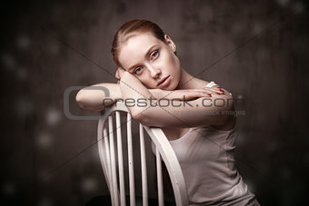 beautiful woman sitting on a white chair
