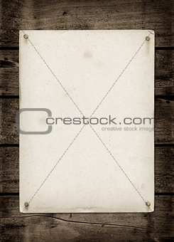 Old textured paper sheet on a dark wood table