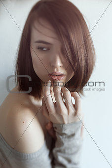Portrait of beautiful woman covering face with palm