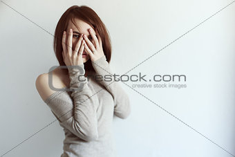 Beautiful grunge woman covering face with palm