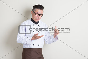Mature Asian Chinese chef thumb up
