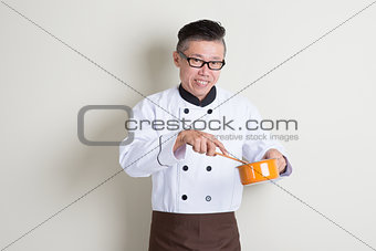 Mature Asian Chinese chef cooking