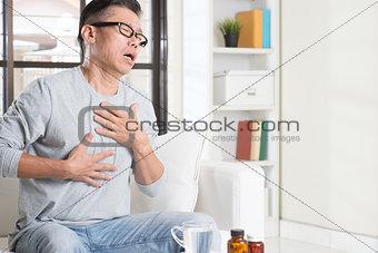 Mature Asian man heartpain
