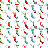 Seamless pattern with  textile Santa socks on white.