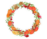 Round festive wreath with fruits and leaves.