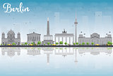 Berlin skyline with grey building, blue sky and reflections