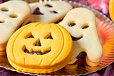 pumpkin-shaped and ghost-shaped cookies