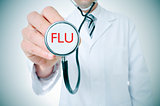 doctor with a stethoscope with the word flu, vignetted
