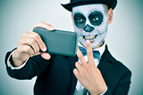 man with calaveras makeup taking a selfie