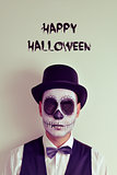 text happy halloween and man with calaveras makeup