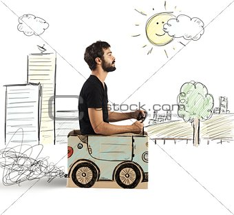Cardboard car in drawing city