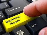 Business News - Written on Yellow Keyboard Key.