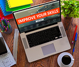 Improve Your Skills Concept on Modern Laptop Screen.