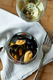 Mussels and wine on a table