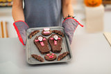 Closeup on tray with Halloween cookies in hands of housewife