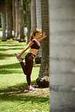 Woman Doing Stretching Before Sports Training At Morning