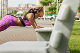 Woman Training Pectorals Doing Pushups On Street Bench