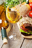 White wine glass and sandwiches