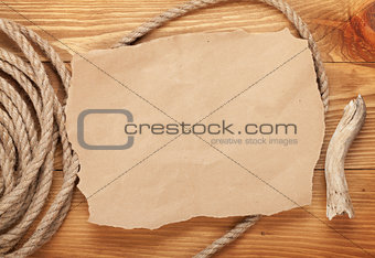Old paper and rope on wooden textured background