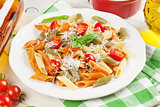 Colorful penne pasta and white wine