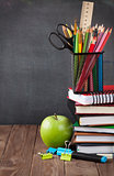 School and office supplies and apple