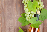 Bunch of grapes and white wine bottle