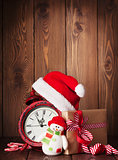 Christmas gift box, alarm clock and snowman toy