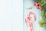 Candy cane and christmas tree on wooden table