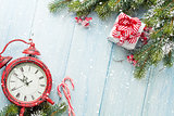 Christmas gift box, alarm clock, candy cane and fir tree