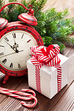 Christmas alarm clock, gift box and fir tree branch