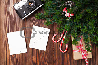Blank photo frames with gift, pine tree and camera