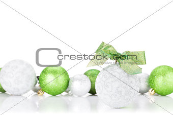 Green and silver christmas baubles