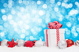 Christmas background with baubles, gift box and bokeh