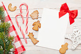 Christmas greeting card, gingerbread cookies and snow fir tree