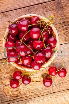 fresh cherries on wooden