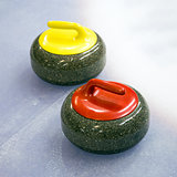 Two curling stone on Ice