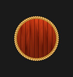 Round wooden frame with rope isolated on dark background