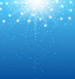 Abstract blue background with sunbeams and shiny stars